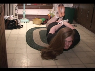 Tightly cleave gagged and hogtied woman