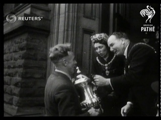 FOOTBALL: 1949 FA Cup: Victorious Wolves team welcomed home after winning FA Cup (1949)