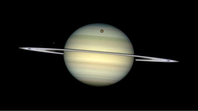 Four of Saturn's moons parade by their parent artist's impression