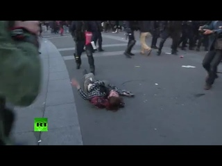 Police throw protester into ground head first at Paris election demo