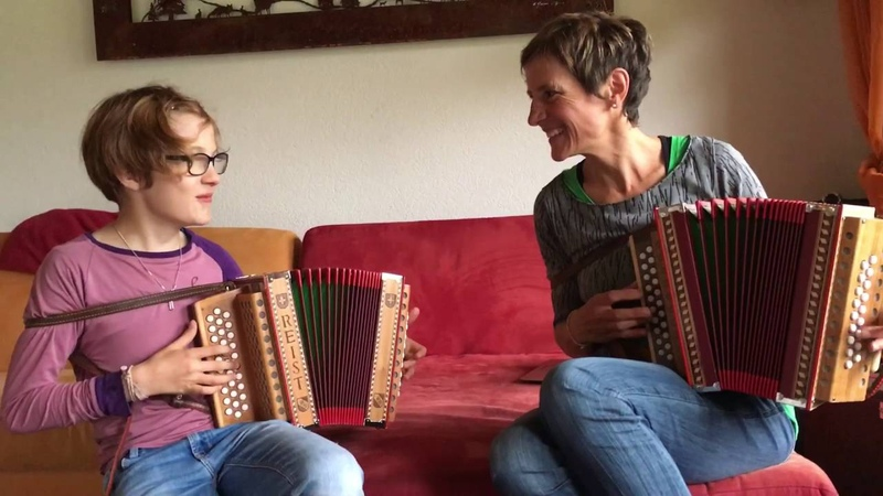 Mom and Daughter play Swiss accordion